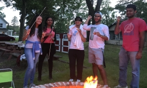 Adelphi Physics Research Students enjoying Smores at the Smithtown Historical Society